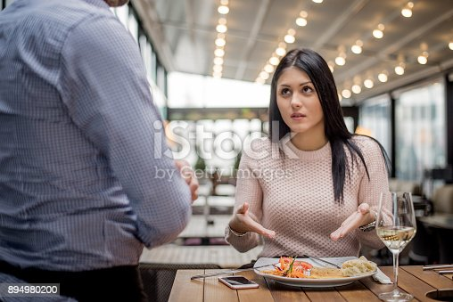 istock Portrait of woman complaining about food quality in restaurant. 894980200