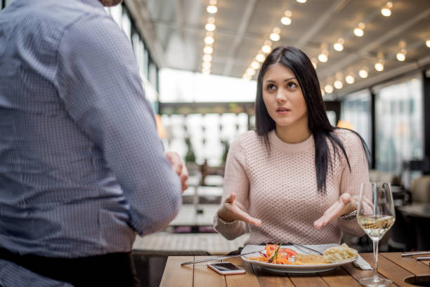 Portrait of woman complaining about food quality in restaurant. stock photo