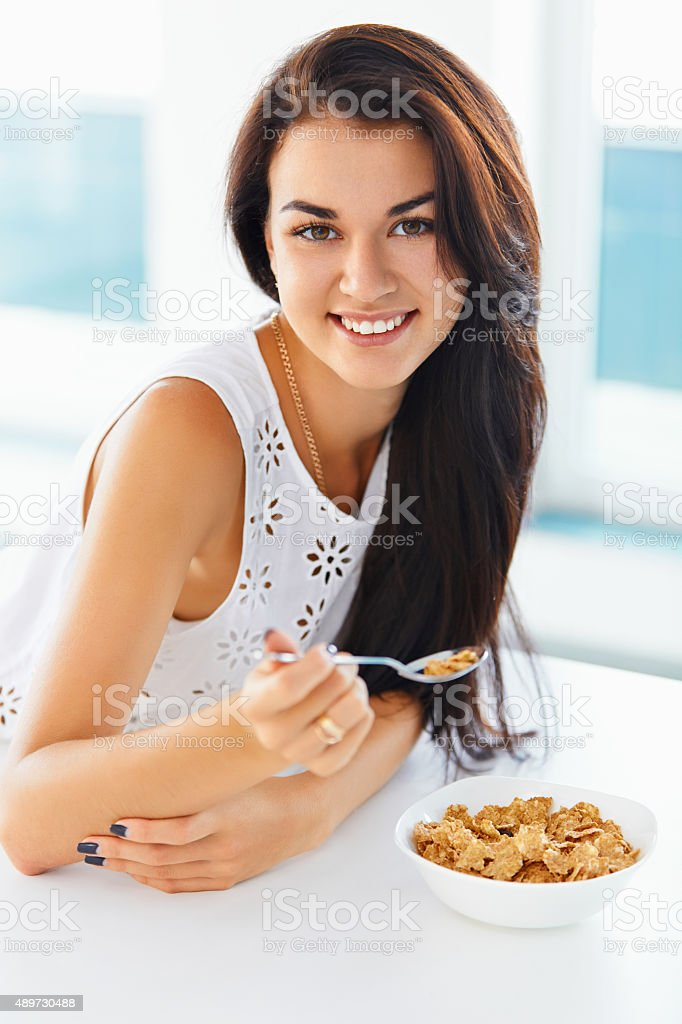 Portrait of woman having healthy breakfast and smiling stock photo
