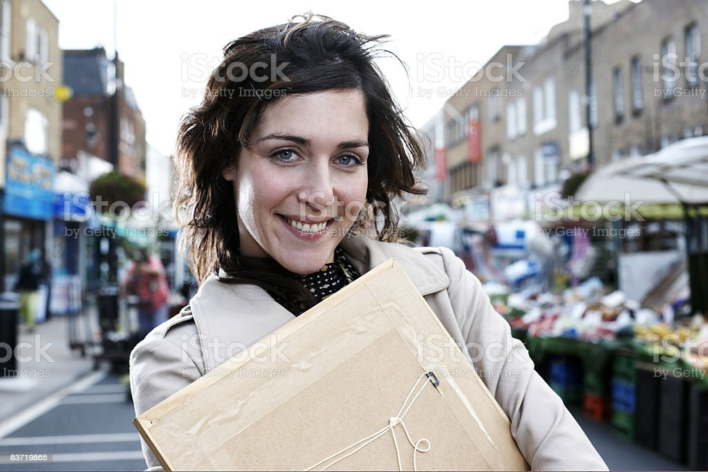 Portrait of woman holding picture frame royalty-free stock photo