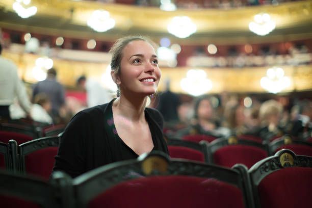 portrait of woman in auditorium of theatre - classical style stock photos and pictures