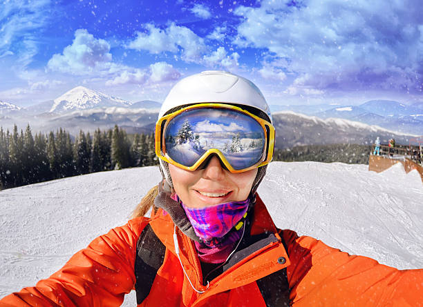 Portrait of woman in Carpathian mountains, Bukovel Portrait of woman in Carpathian mountains, Bukovel, Ukraine ski goggles stock pictures, royalty-free photos & images