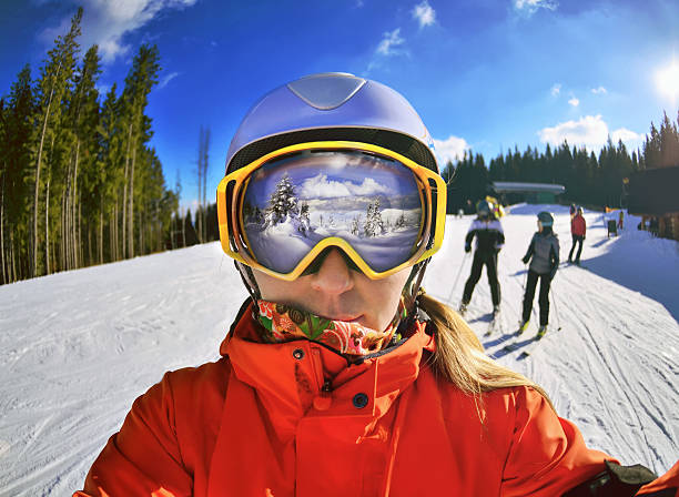 Portrait of woman in Carpathian Mountains Portrait of woman in Carpathian Mountains, Bukovel ski goggles stock pictures, royalty-free photos & images
