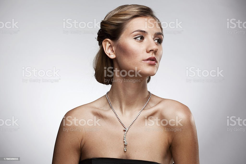 Portrait of  woman in exclusive jewelry royalty-free stock photo