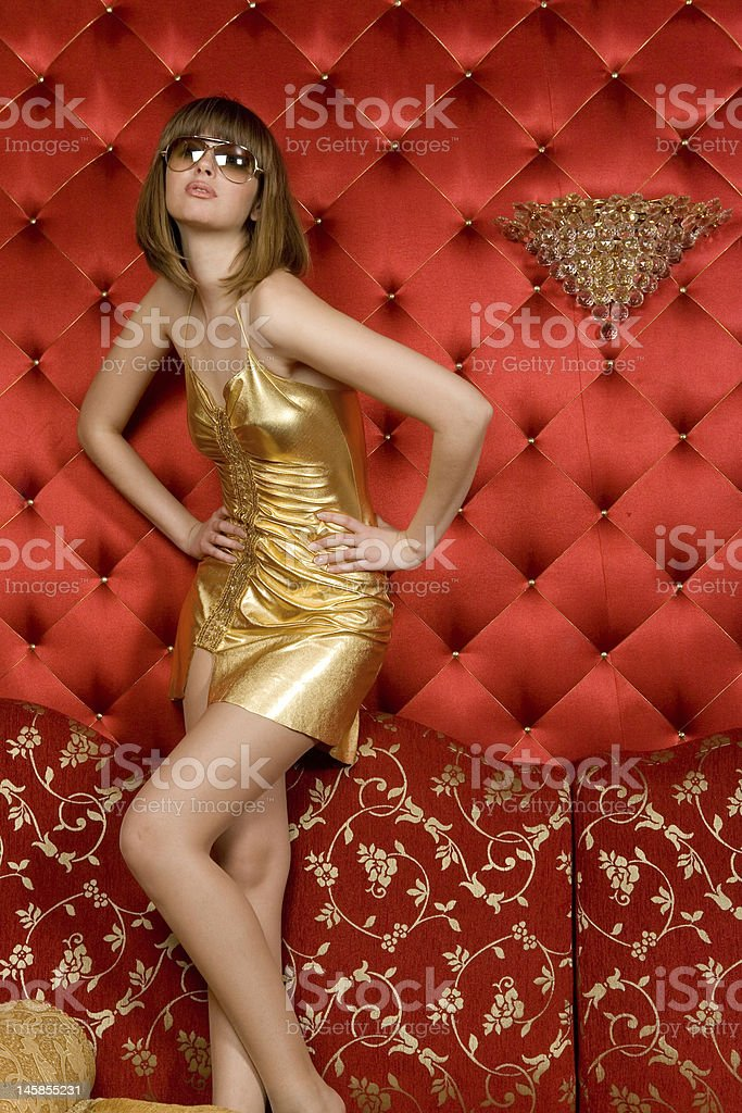 Portrait of woman in gold dress luxury interior royalty-free stock photo