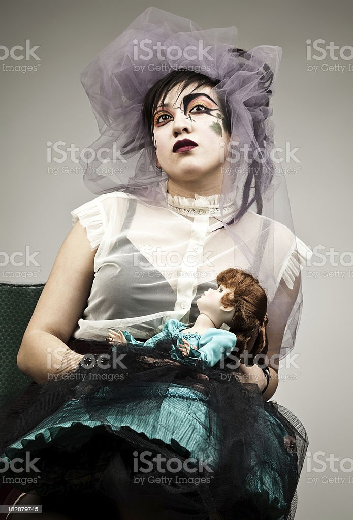 Portrait of Woman in Harajuku Attire Holding Doll. Vertical Format. royalty-free stock photo