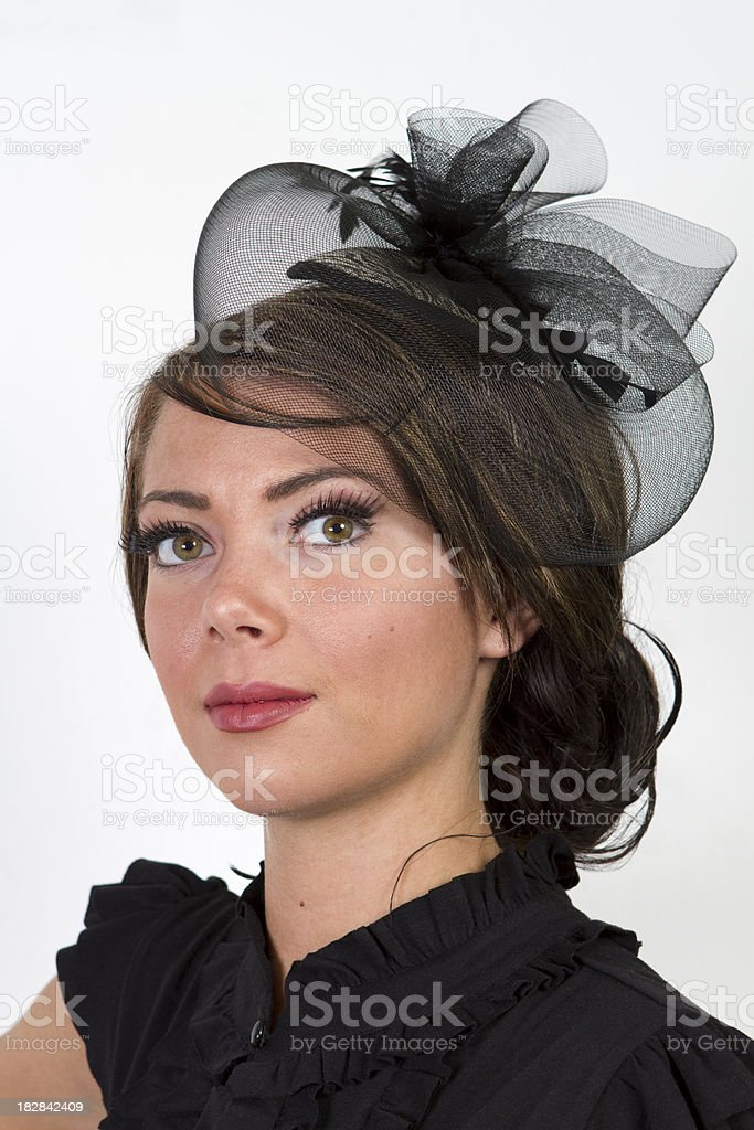 Portrait of a beautiful woman with hazel eyes in a retro period...
