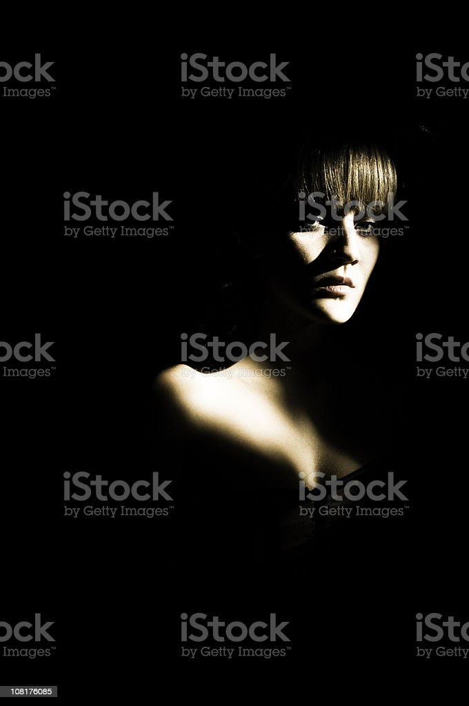 Portrait of Woman in Shadows royalty-free stock photo