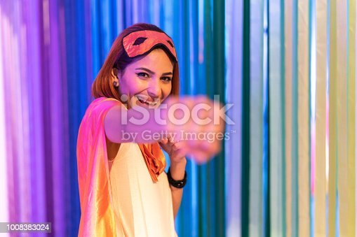 516318379istockphoto Portrait of woman in superhero costume 1008383024