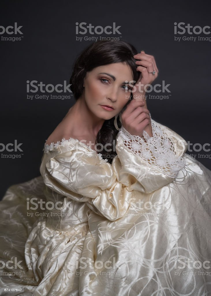portrait of woman in vintage dress stock photo