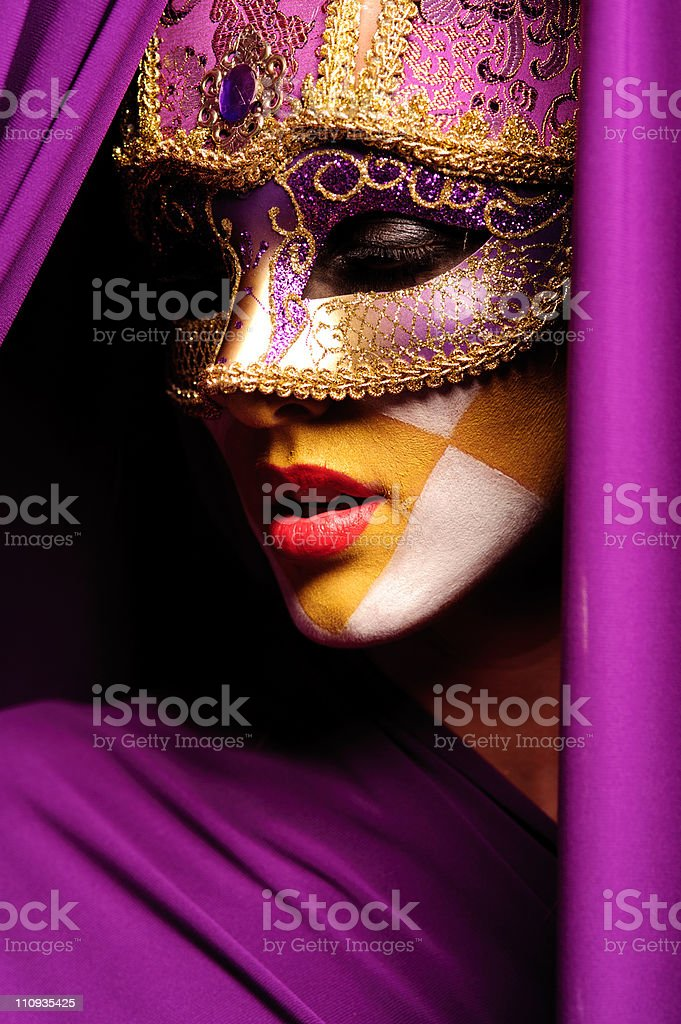portrait of woman in violet mask royalty-free stock photo