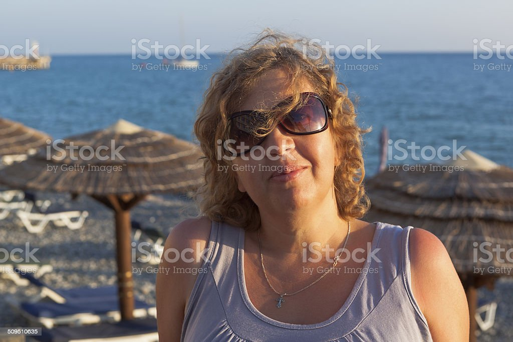 Portrait of woman on a beach in the setting sun stock photo
