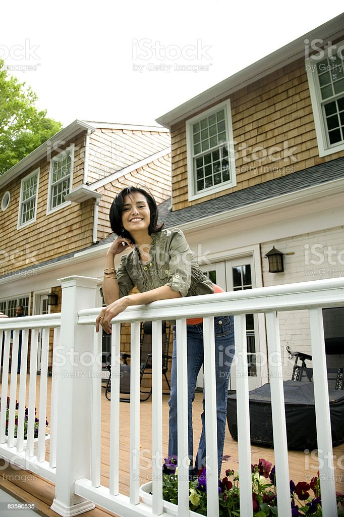 Portrait of woman on her back porch royalty free stockfoto