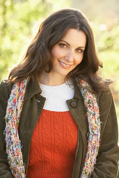 Portrait Of Woman Outdoors In Autumn Landscape stock photo