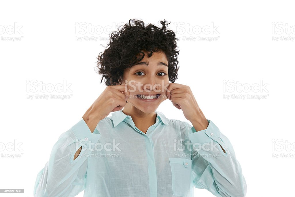 portrait of woman pinching cheeks and smiling stock photo