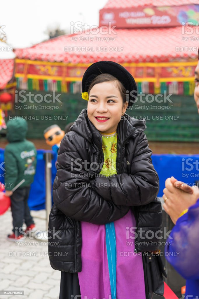 Hanoi, Vietnam - Feb 7, 2015: Portrait of woman Puppetry at break time before next puppetry show at Vietnamese lunar new year festival organized at Vinschool, Vinhomes Times City, Minh Khai stock photo