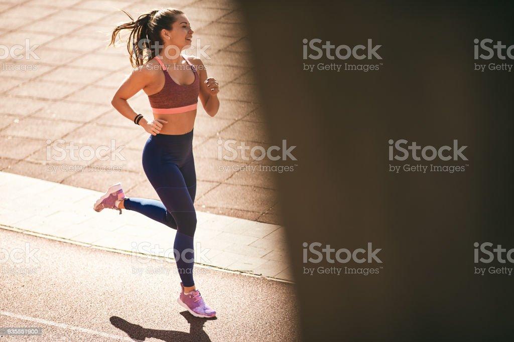 Portrait of woman running. stock photo