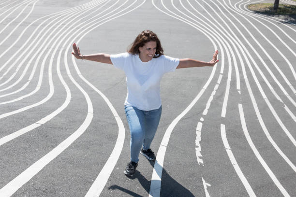 Portrait of woman showing her strength to separate some lines. Creative and strong concept. stock photo