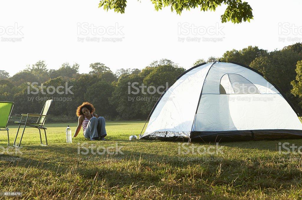 Portrait of woman sitting by tent zbiór zdjęć royalty-free