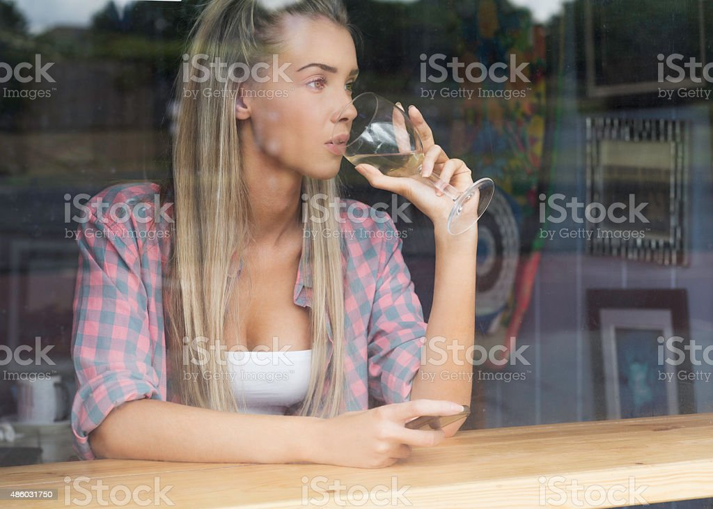 Portrait of Woman Sitting in Bar stock photo