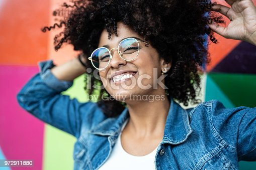 istock Portrait of Woman Smiling with Colorful background 972911880