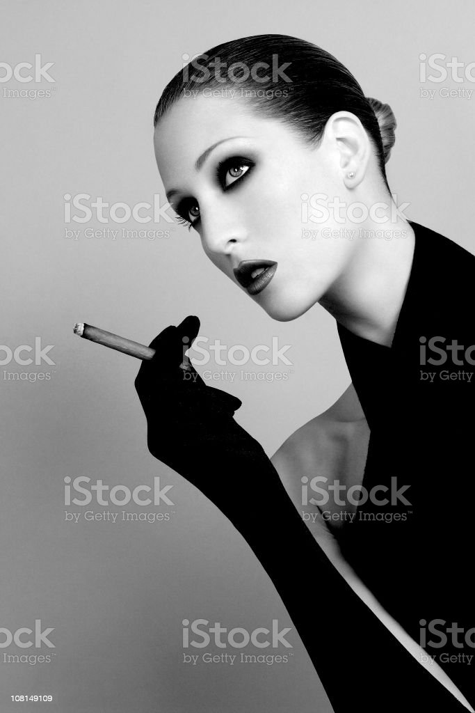Portrait of Woman Smoking Cigar, Black and White royalty-free stock photo