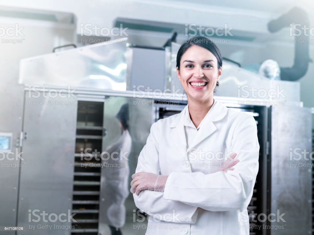 Portrait of Woman Specialist at Work in Production Facility stock photo