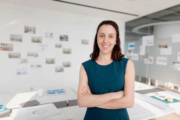 portrait of woman standing in design office - curator stock pictures, royalty-free photos & images