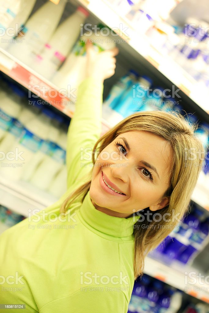 Portrait of woman taking purchases at a supermarket. royalty-free stock photo
