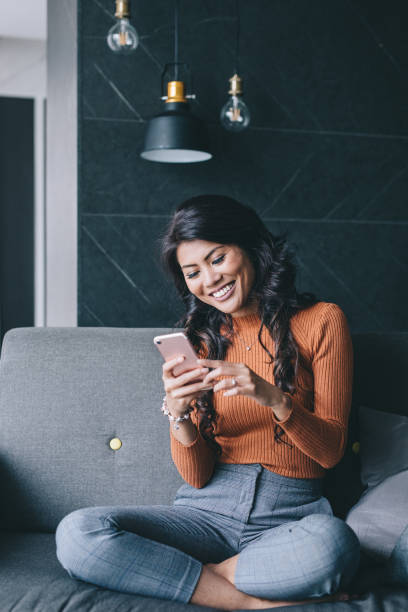 Portrait of woman using her smartphone. stock photo