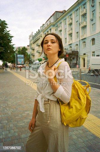 Portrait of young Caucasian  woman walking  in Kyiv city