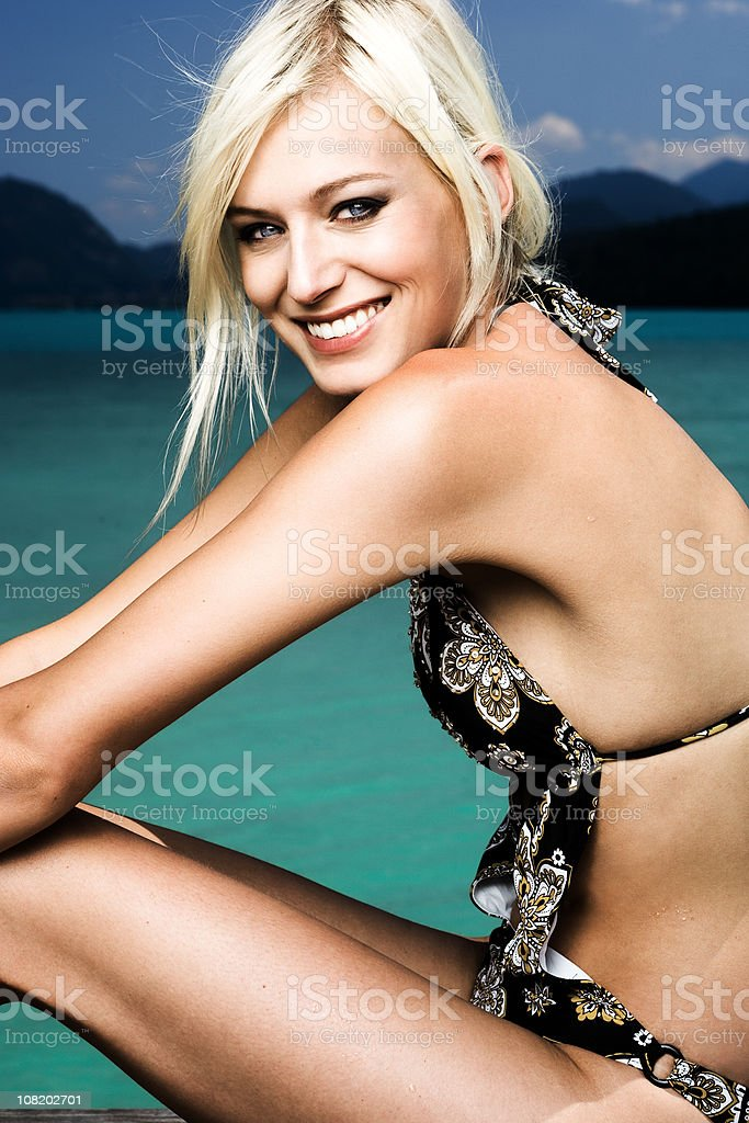 Portrait of Woman Wearing Bathing Suit, Lake in Background royalty-free stock photo