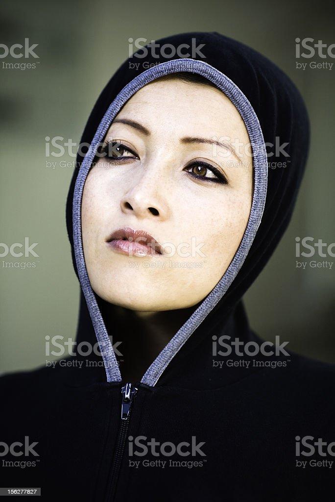 Portrait of Woman Wearing Hood royalty-free stock photo