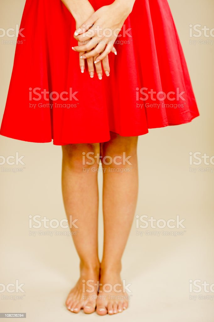 Portrait of Woman Wearing Red Skirt and Bare Feet royalty-free stock photo