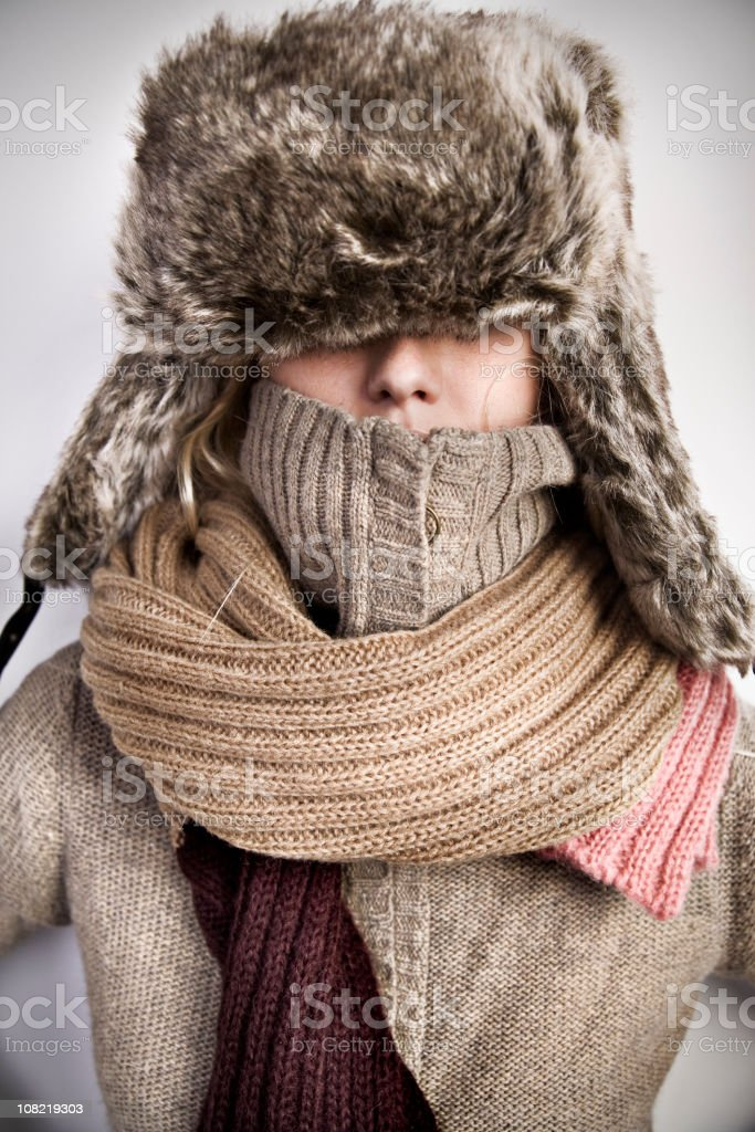 Portrait of Woman Wearing Turtle Neck, Winter Hat and Scarf stock photo