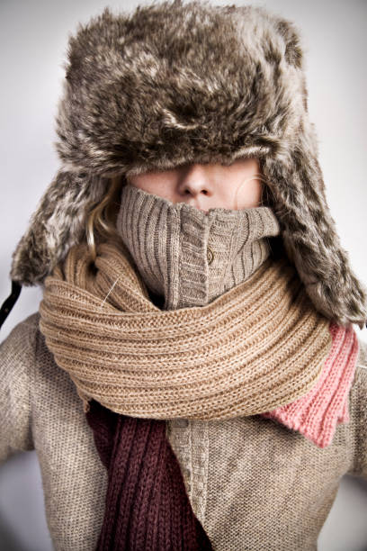 Portrait of Woman Wearing Turtle Neck, Winter Hat and Scarf  warm clothing stock pictures, royalty-free photos & images