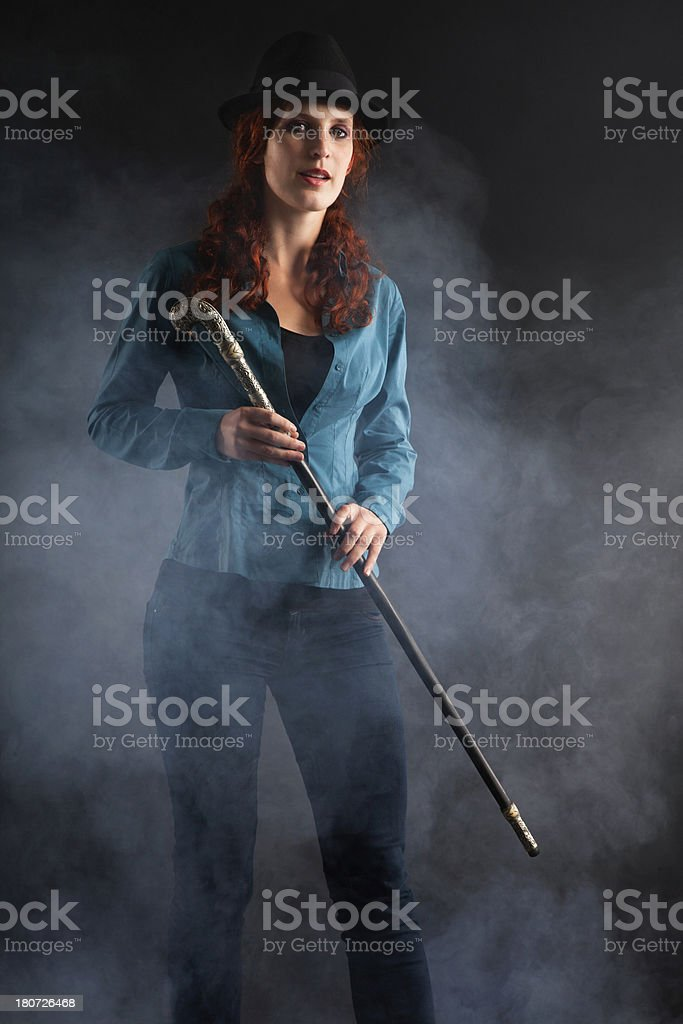 Portrait Of Woman With A Stick royalty-free stock photo