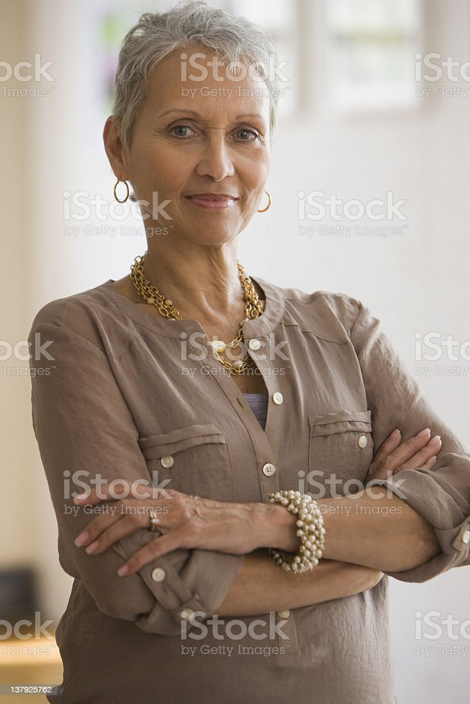 Portrait of woman with arms crossed in front stock photo