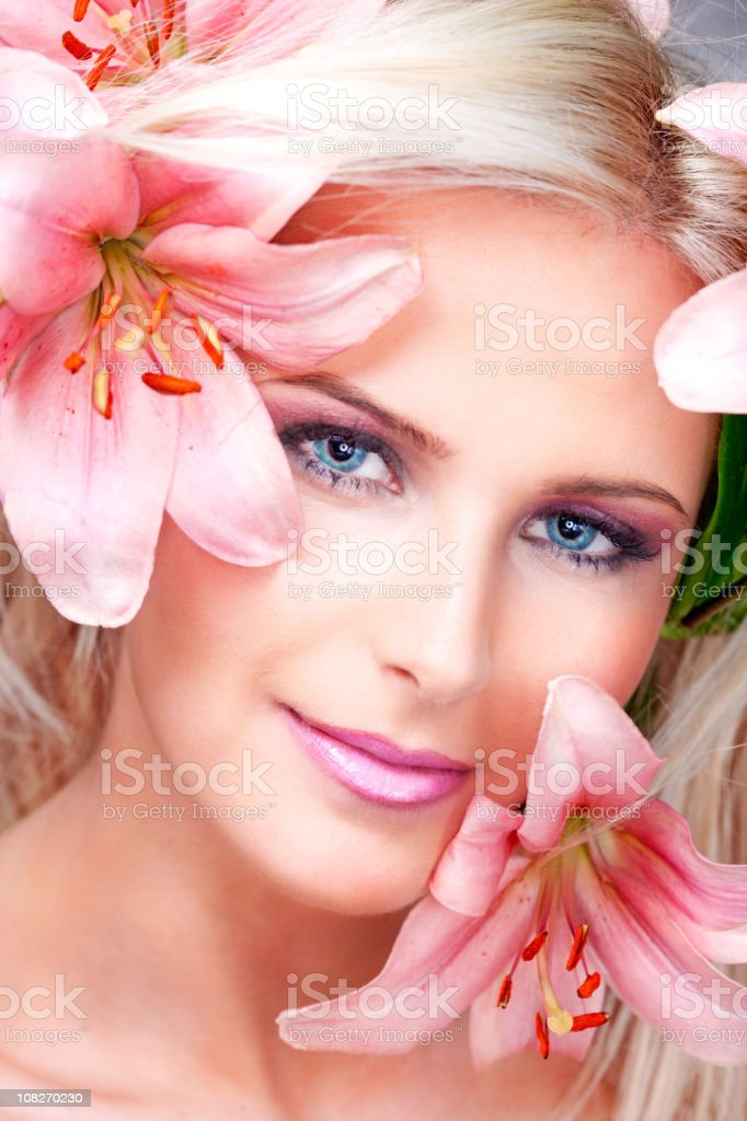 Portrait of Woman with Flowers Surrounder Her Face royalty-free stock photo
