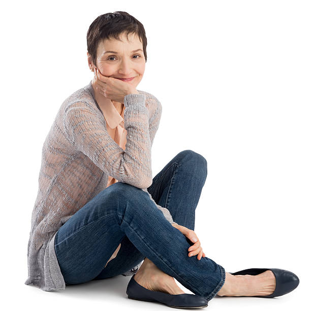portrait of woman with hand on chin sitting - sitting on floor stock photos and pictures