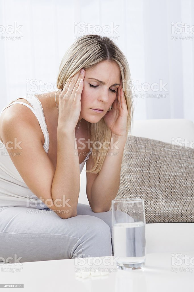 Portrait of woman with migraine royalty-free stock photo