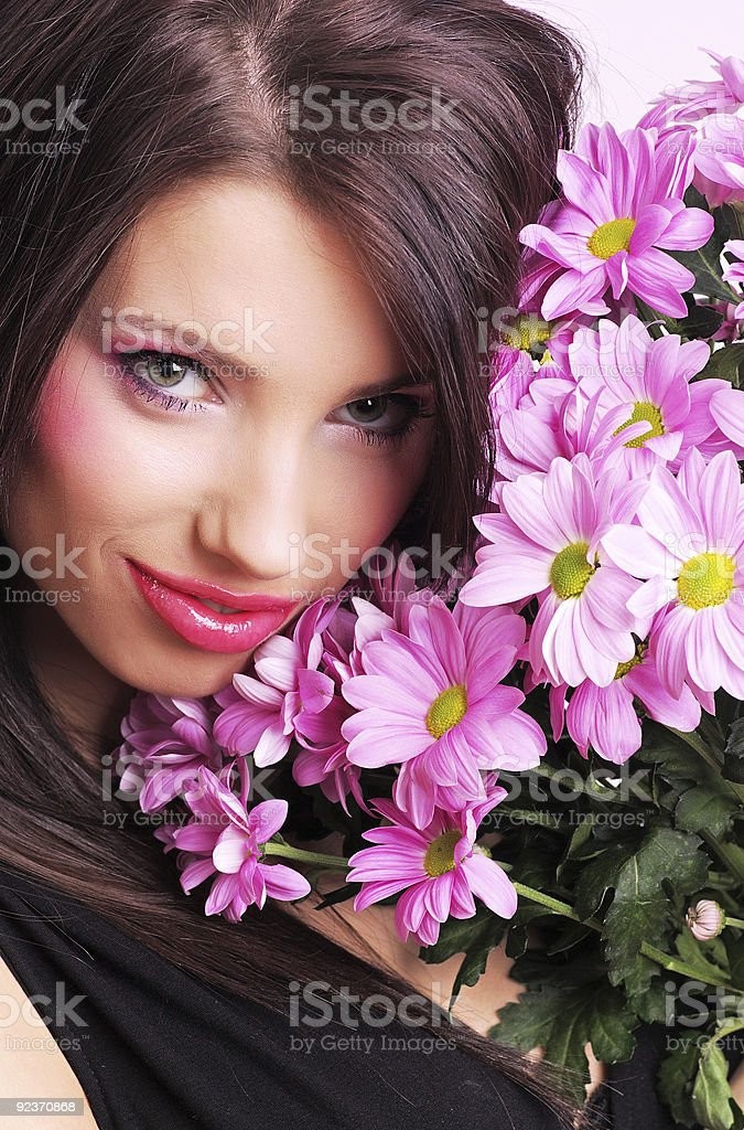 Portrait of woman with pink flowers royalty-free stock photo