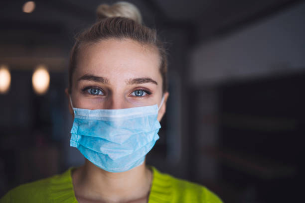 Portrait of woman with protective face mask - stock photo