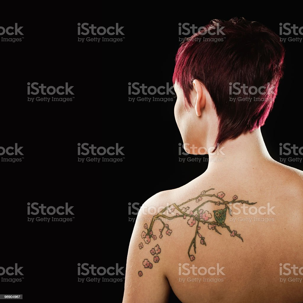 Portrait of Woman With Tattoo on Back royalty-free stock photo