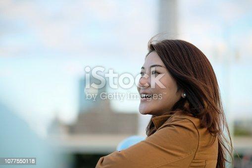 istock Portrait of woman with Tokyo sky-tree 1077550118