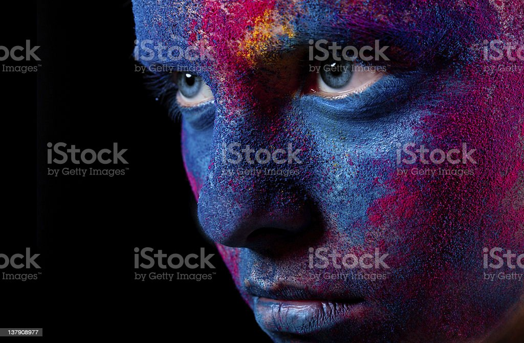 Portrait of woman with unusual paint make-up stock photo