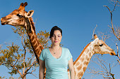 portrait of woman  with virtual background giraffes in the savanna