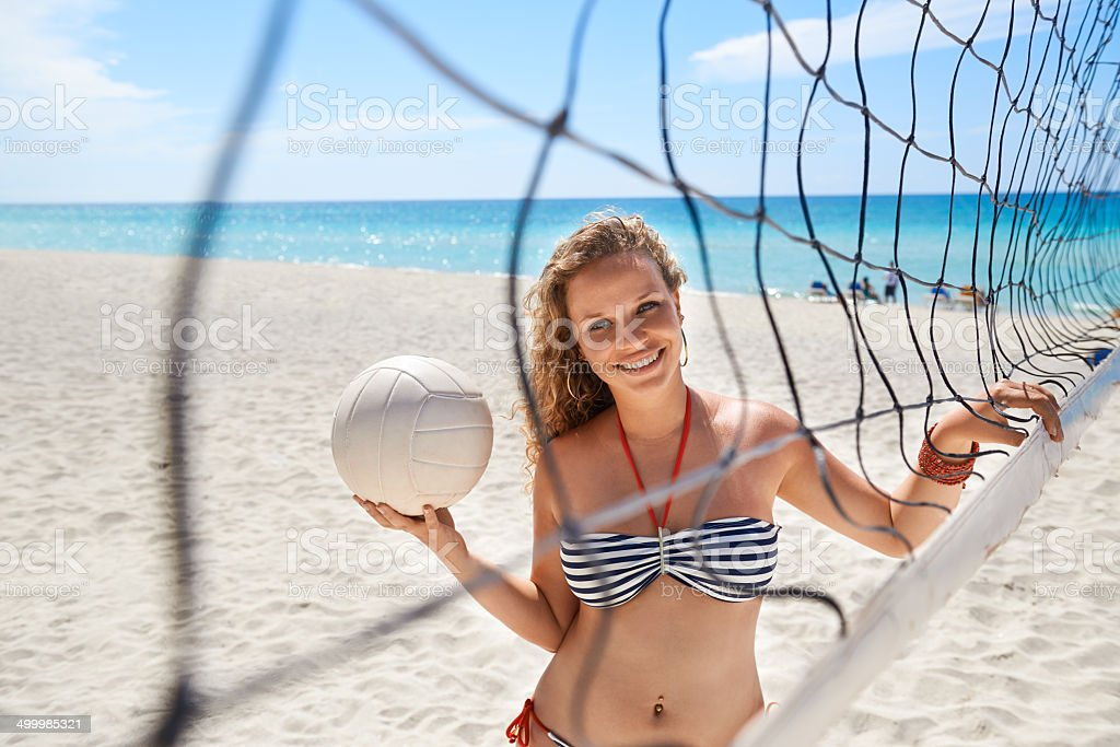 Portrait of woman with volleyball playing beach volley stock photo