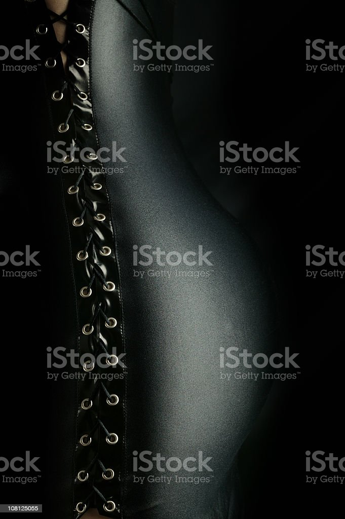 Portrait of Woman's Back Wearing Corset Lace Up stock photo