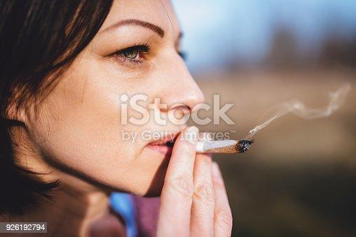 istock Portrait of women smoking outdoors 926192794
